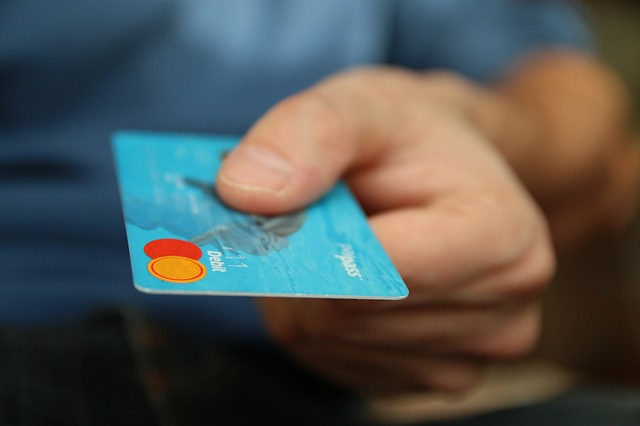 Close up image of a hand holding a credit card