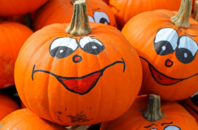 Pumpkins with smiling faces painted on them