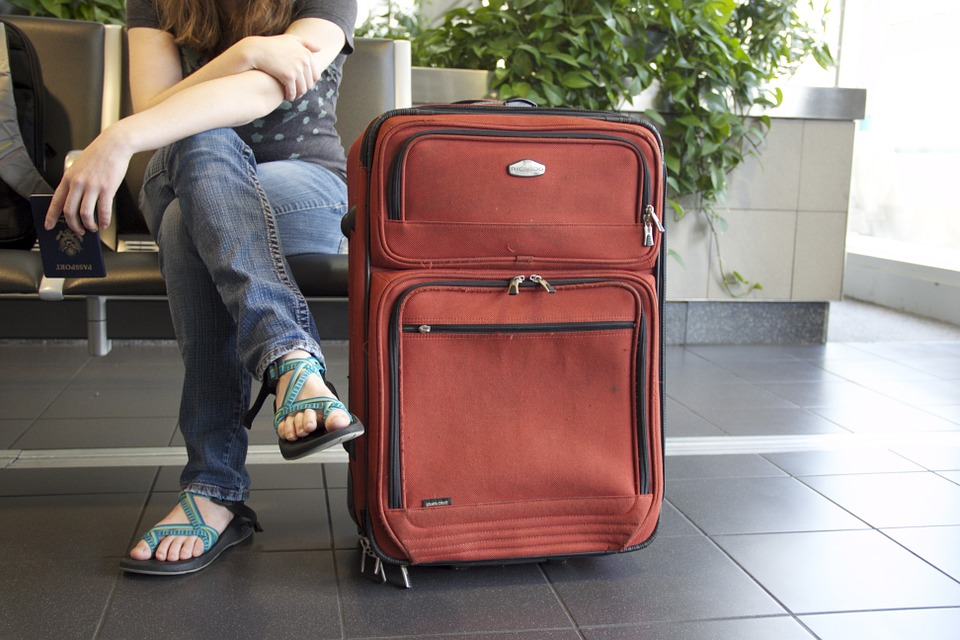Woman traveler sitting with a luggage