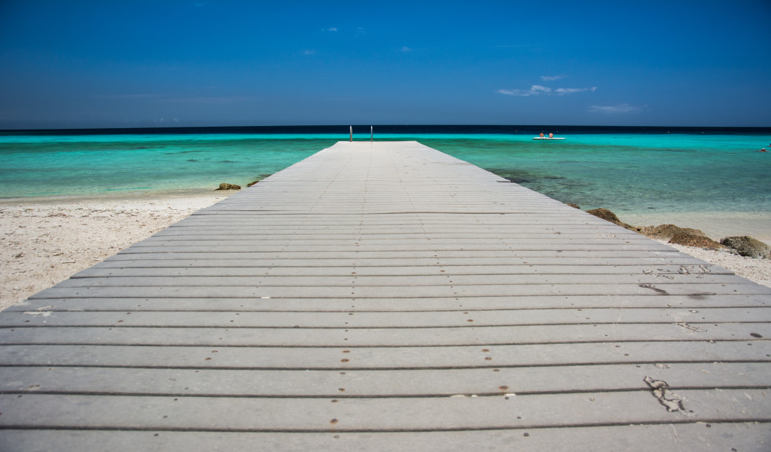 A jetty leading into the shallow sea water