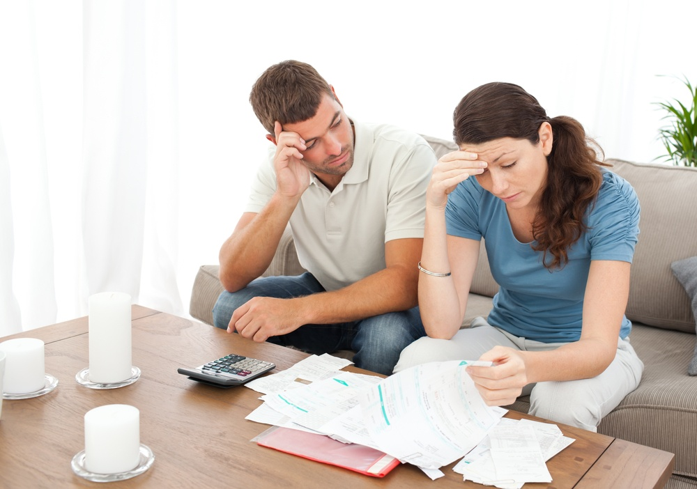Couple fretting over unexpected expenses