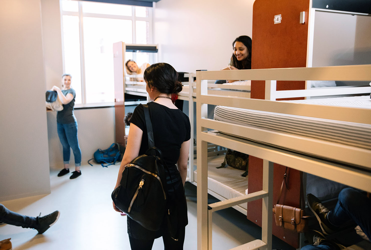 students in dorm room with bunk beds