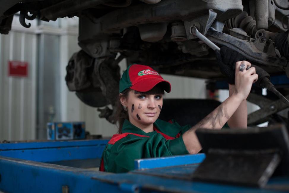 female mechanic doing repairs