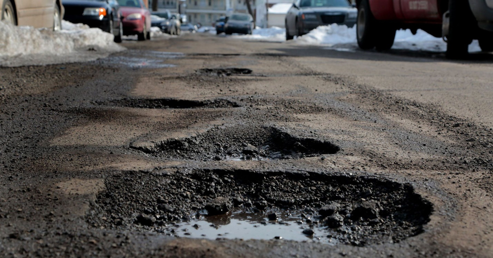 road with damaging potholes