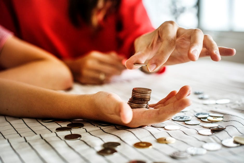 a person counting pennies