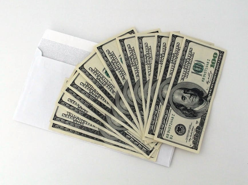 cash on top of an envelope