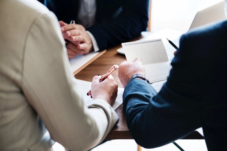 people signing a loan agreement with a responsible lender
