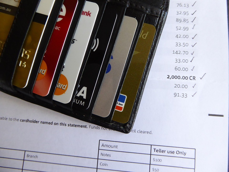 wallet sitting on top of a credit card invoice