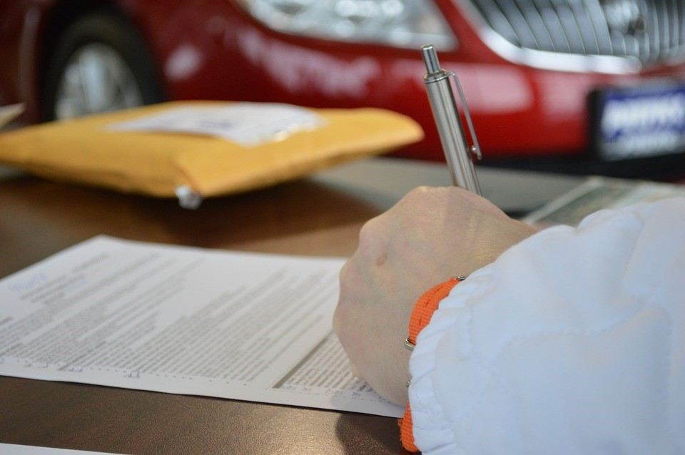 person signing a personal loan contract