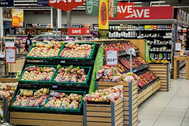 Fruits at a grocery store - you can save on groceries with grocery saving apps