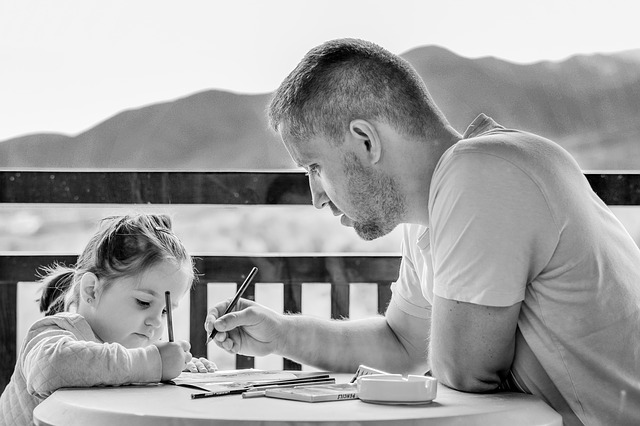 dad teaching daughter about bad financial habits