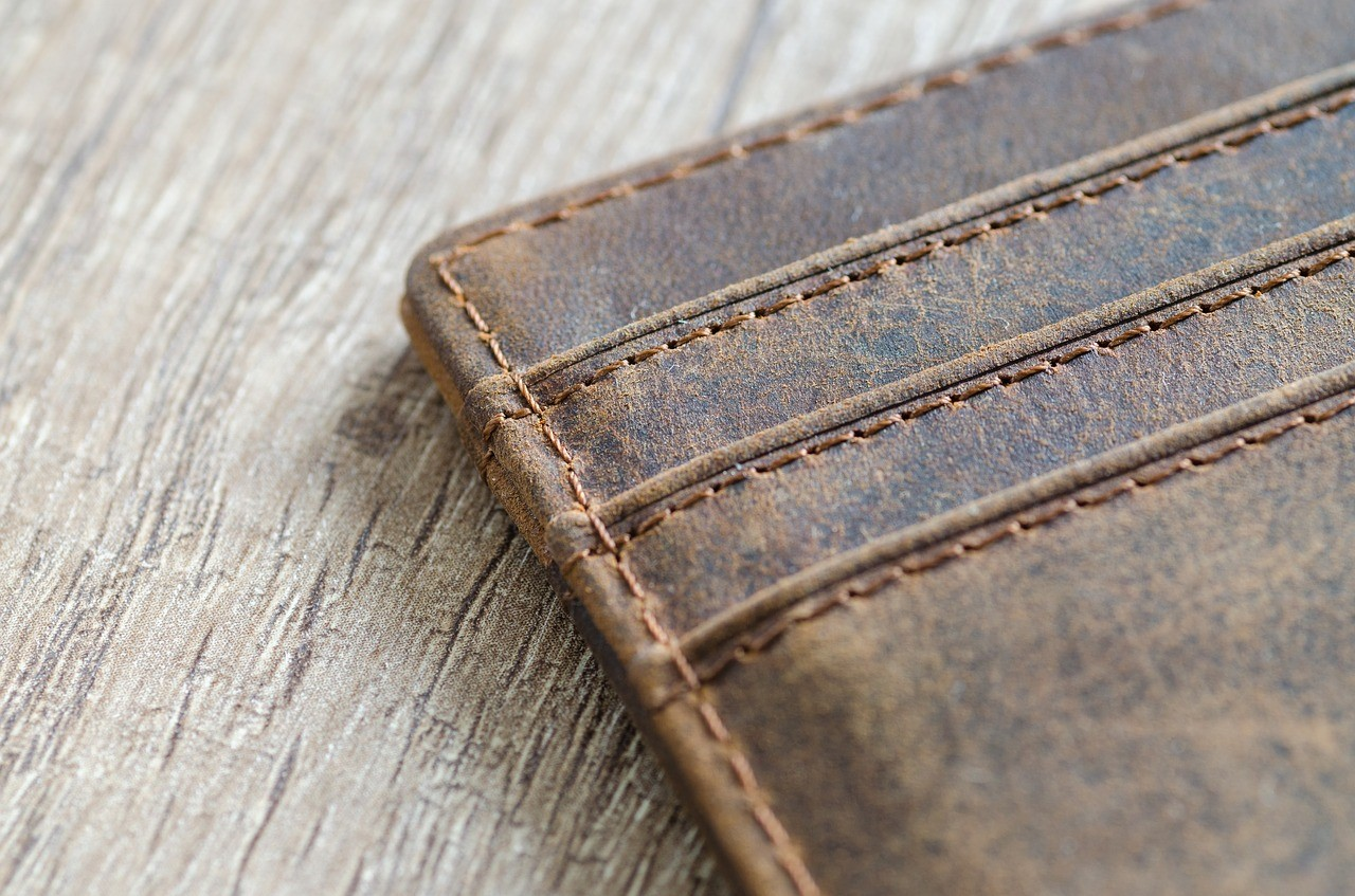 empty brown wallet on wooden table