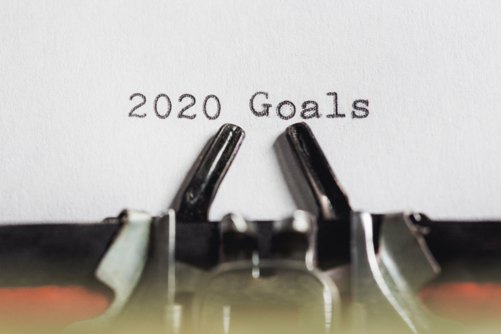 2020 Goals typed on white paper in front of typewriter guide