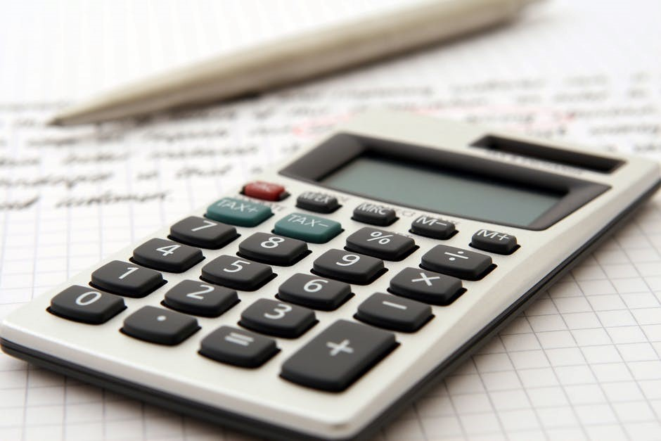 Calculator and a pen to prepare a budget