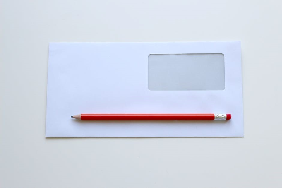 empty envelope and pencil