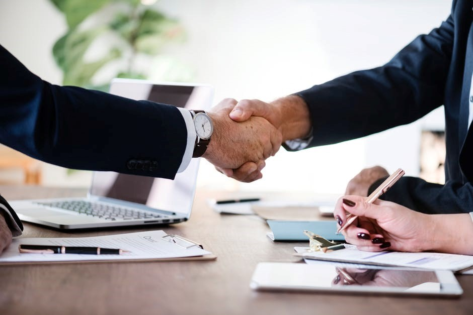 people shaking hands at a meeting