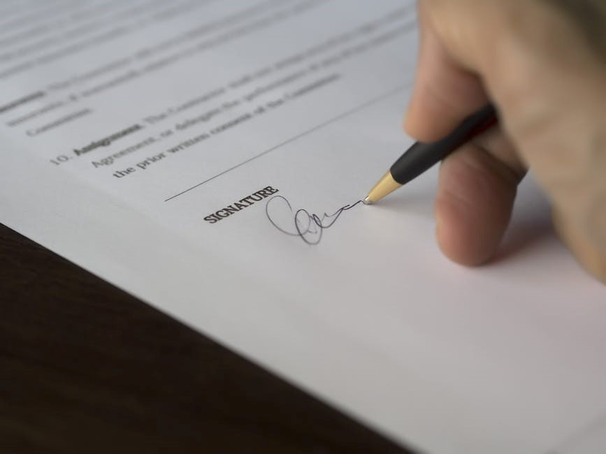 A person signing a contract to lease a car