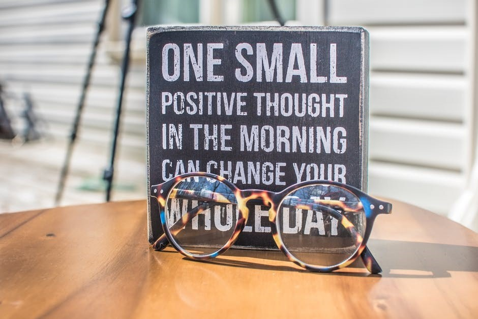 sign saying one small positive thought in the morning can change your whole day
