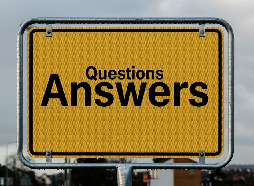street sign with questions answers written on it