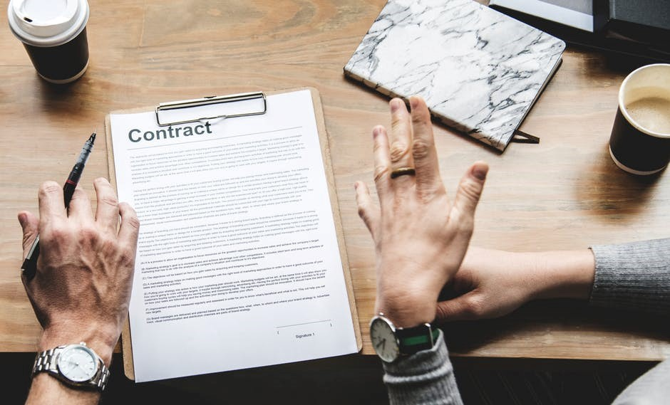 two people reviewing a contract
